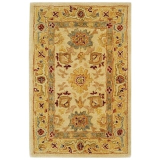 Handmade Heirloom Ivory/ Gold Wool Rug (2' x 3')