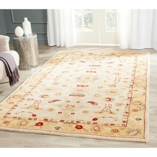 Handmade Tribal Ivory/ Gold Wool Rug (9&#39; x 12&#39;)
