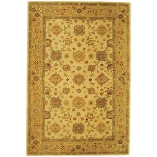 Handmade Heirloom Ivory/ Gold Wool Rug (6' x 9')