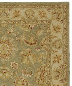Handmade Antiquities Gem Green Wool Rug (5' x 8')