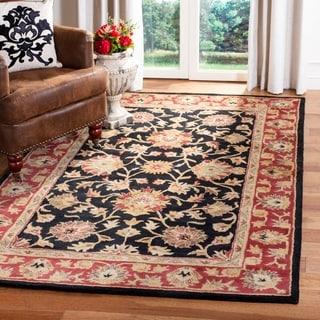 Safavieh Handmade Heritage Kerman Black/ Peach Wool Rug (6' x 9')