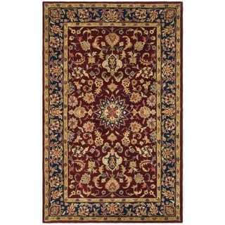 Handmade Classic Kerman Burgundy/ Navy Wool Rug (5' x 8')