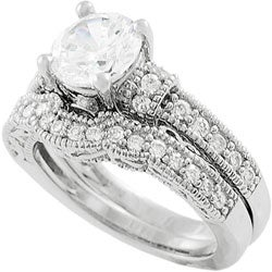 Journee Collection Sterling Silver Round-cut CZ Highlighted with Bezel-set and Pave-set Round CZs Br