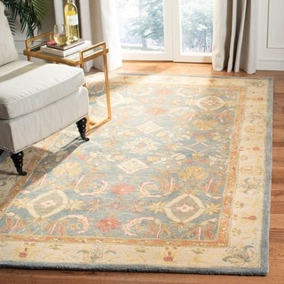 Handmade Legacy Light Blue Wool Rug (9'6 x 13'6)