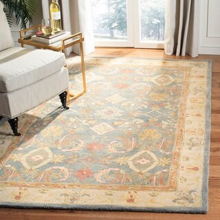 Handmade Legacy Light Blue Wool Rug (6' x 9')