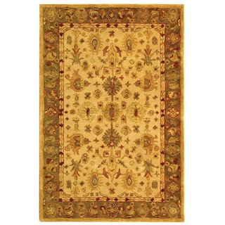 Handmade Heirloom Ivory/ Light Green Wool Rug (4' x 6')