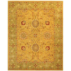 Handmade Antiquities Isfan Dark Gold/ Light Green Wool Rug (6' x 9')
