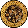 Handmade Antique Mashad Black/ Ivory Wool Rug (8' Round)