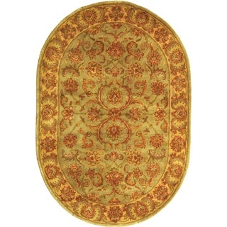 Handmade Heritage Kermansha Green/ Gold Wool Rug (4'6 x 6'6 Oval)