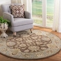 Handmade Heritage Kerman Brown/ Blue Wool Rug (8' Round)