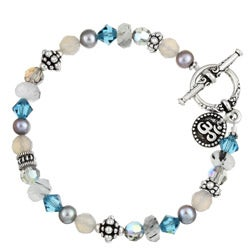 Charming Life Silverplated Teal Blue Crystal Om Charm Bracelet
