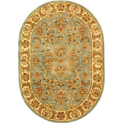 Safavieh Handmade Heritage Kermansha Blue/ Beige Wool Rug (4'6 x 6'6 Oval)