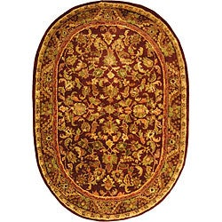 Handmade Exquisite Wine/ Gold Wool Rug (7'6 x 9'6 Oval)