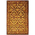 Handmade Kerman Wine/ Gold Wool Rug (5' x 8')