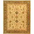 Handmade Heirloom Ivory/ Light Green Wool Rug (9'6 x 13'6)