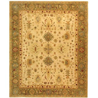 Handmade Heirloom Ivory/ Light Green Wool Rug (9' x 12')