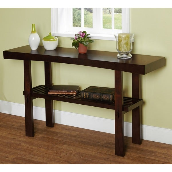The japanese sofa table has clean modern lines and solid wood with a