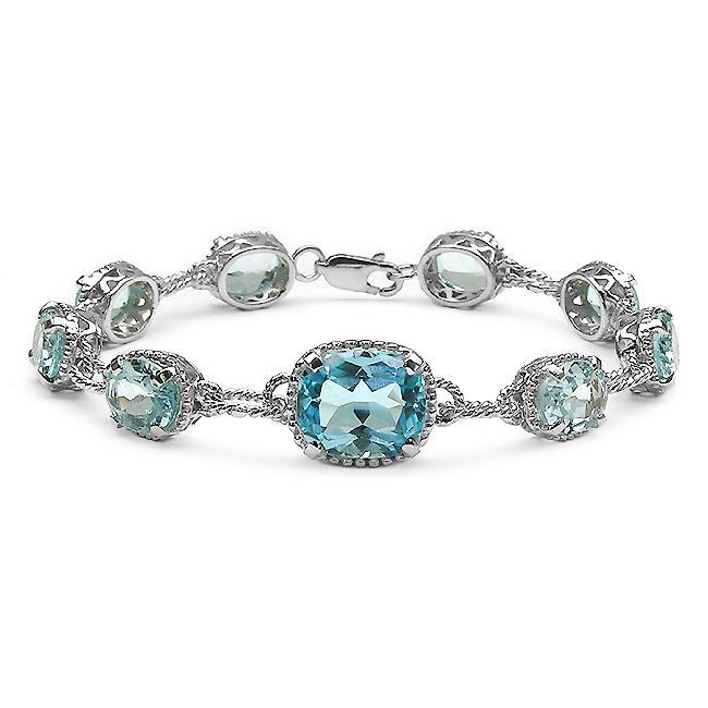 Malaika Sterling Silver Blue Topaz Rope Design Link Bracelet