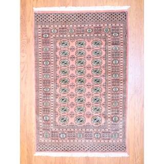 Pakistani Hand-knotted Bokhara Peach Wool Rug (4' x 6')