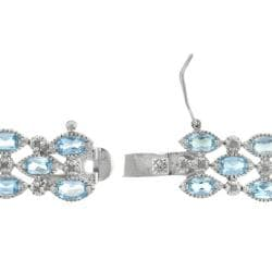 Dolce Giavonna Sterling Silver Blue Topaz and Diamond Accent 3-row Bracelet