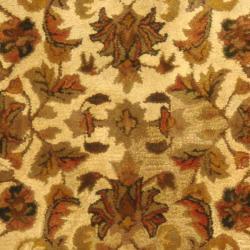 Handmade Heritage Ivory Wool Rug (7'6 x 9'6 Oval)