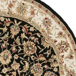 Hand-hooked Chelsea Tabriz Black/ Ivory Wool Rug (8' Round)