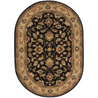 Safavieh Handmade Heritage Kerman Black/ Gold Wool Rug (4'6 x 6'6 Oval)