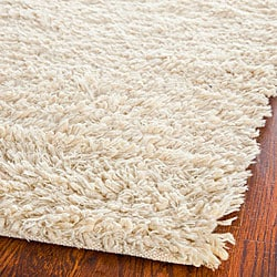 Hand-woven Posh Ivory Wool Shag Rug (2' x 3')