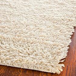 Hand-woven Posh Ivory Wool Shag Rug (5' x 8')