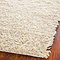 Hand-woven Posh Ivory Wool Shag Rug (6' x 9')