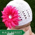 Crocheted White Kufi Hat with Hot Pink Flower