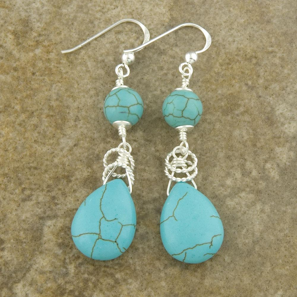 Silver 'Round and Oval' Reconstructed Turquoise Earrings (Thailand)