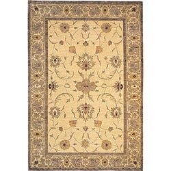 Hand-knotted 'Destiny' Gold Wool Rug (6' x 9')