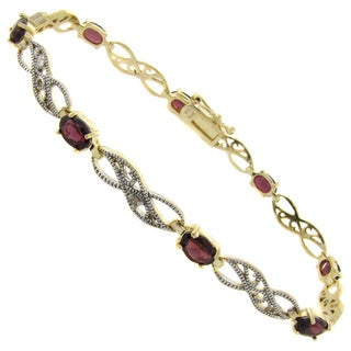 Dolce Giavonna Gold over Silver Garnet and Diamond Accent Filigree Bracelet (I-J, I2-I3)
