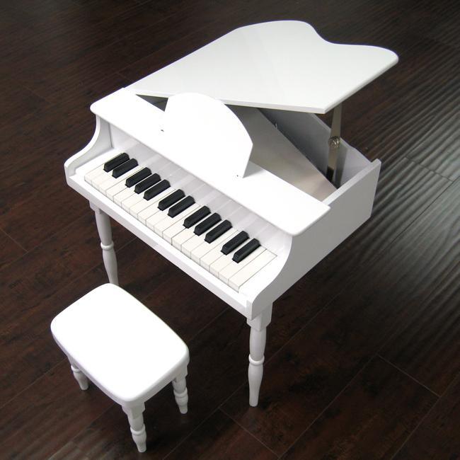childs white baby grand piano
