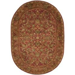 Handmade Heirloom Red Wool Rug (7'6 x 9'6 Oval)