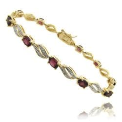 Dolce Giavonna Gold Overlay Garnet and Diamond Accent Marquise Bracelet