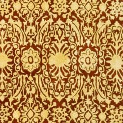 Safavieh Handmade Majestic Maroon/ Ivory N. Z. Wool Rug (4'6 x 6'6 Oval)