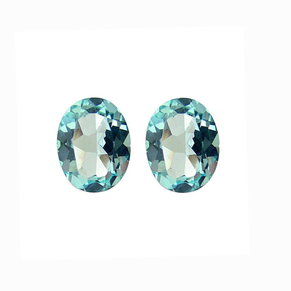 Glitzy Rocks 9x7 Oval-cut Blue Topaz Stones (4 2/5ct TGW) (Set of 2)