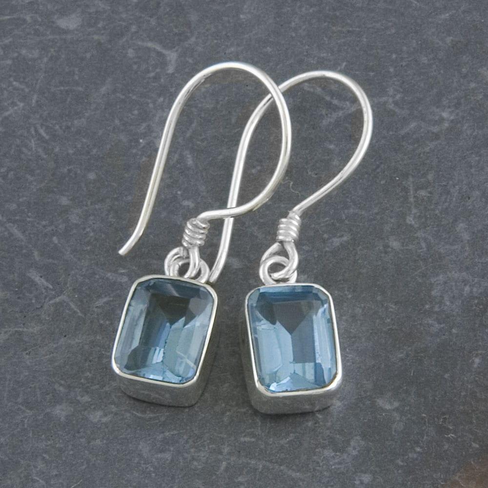 Sterling Silver Emerald-cut Blue Topaz Earrings (Indonesia)