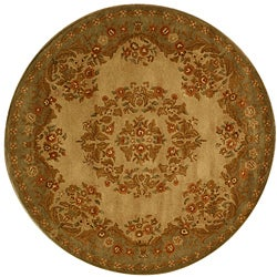 Hand-tufted Mumtaj Gold Wool Rug (6' Round)