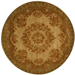 Hand-tufted Mumtaj Gold Wool Rug (6' Round)
