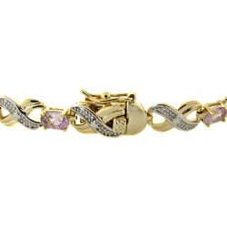 Dolce Giavonna 14k Gold Overlay Amethyst and Diamond 'XO' Bracelet (4 1/2ct TGW)