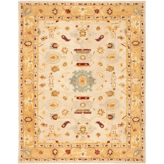 Handmade Tribal Ivory/ Gold Wool Rug (11' x 17')