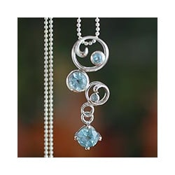 Sterling Silver 'In Circles' Blue Topaz Necklace (India)