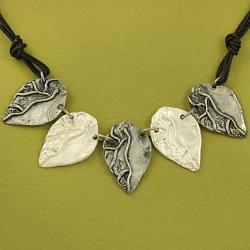 Handcrafted Pewter Two-Tone Detailed Leaves Cord Necklace and Earrings Set ( India)