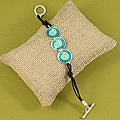 Handcrafted Metal and Enamel 'Pacific Blues' Cord Toggle Bracelet (India)