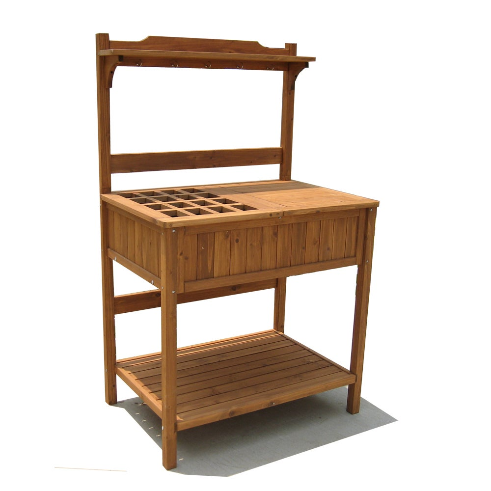 Wood potting bench with recessed storage 14259825 - Potting table with storage ...