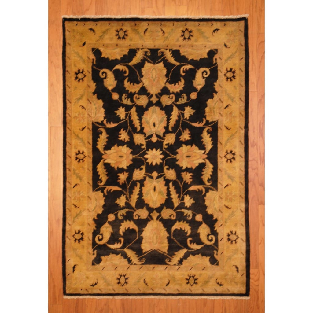 Afghan Hand-knotted Vegetable Dye Black/ Gold Wool Rug (4' x 6')