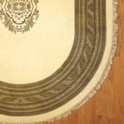 Indo Hand-knotted Tibetan Ivory/ Light Brown Oval Wool Rug (8' x 10')